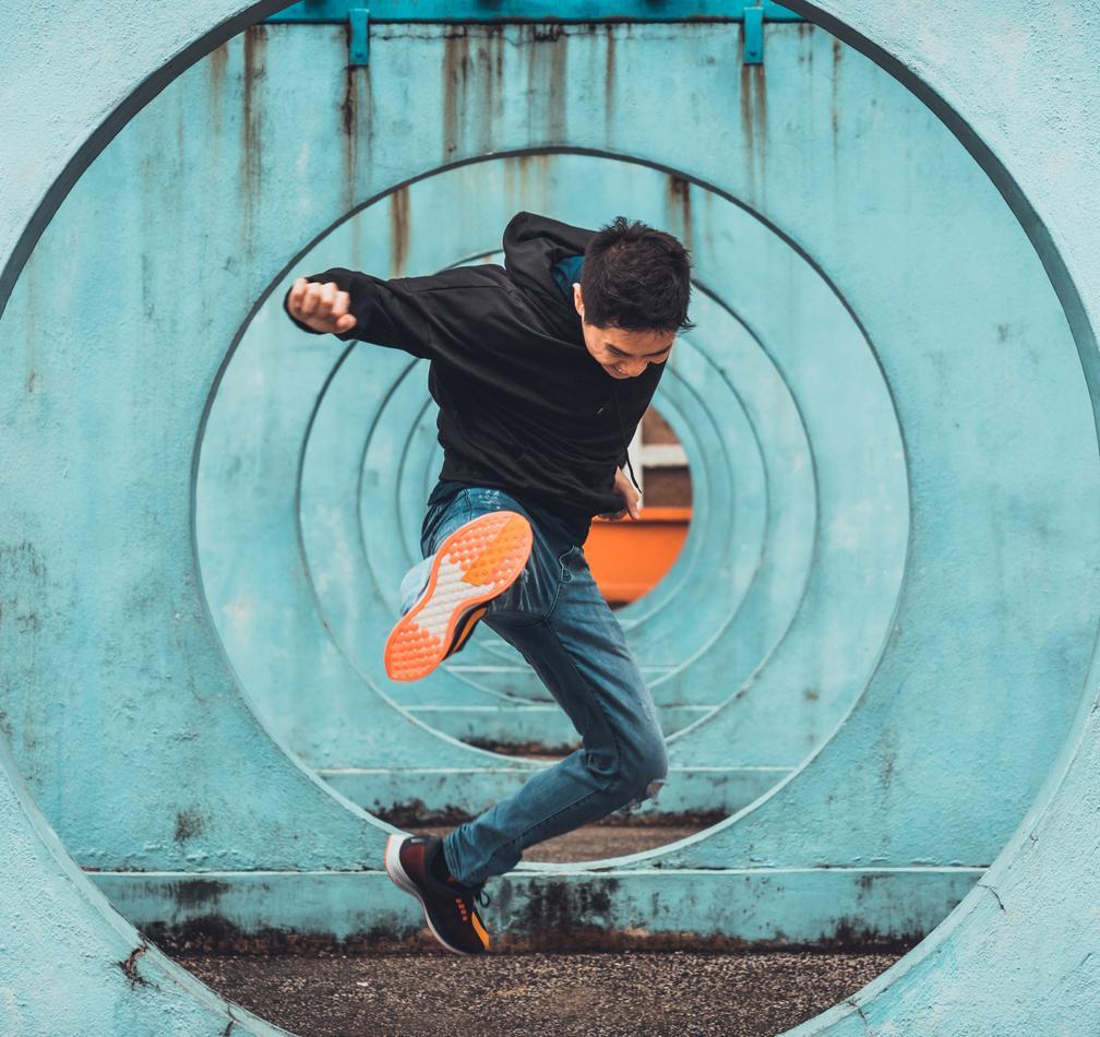 Men jumping kick
